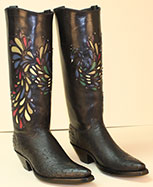 custom black ostrich cowboy boot with inlayed peacock accented with crystal stones on a regal cut top