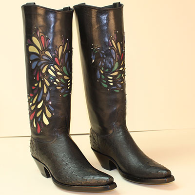 black ostrich custom cowboy boot with inlayed peacock design accented with crystal stones on a regal cut top